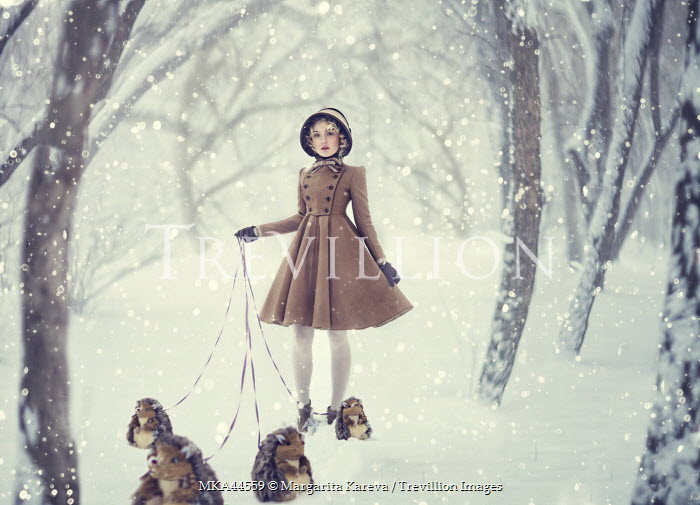 Margarita Kareva GIRL IN SNOW WITH TOY HEDGEHOGS ON LEADS Women