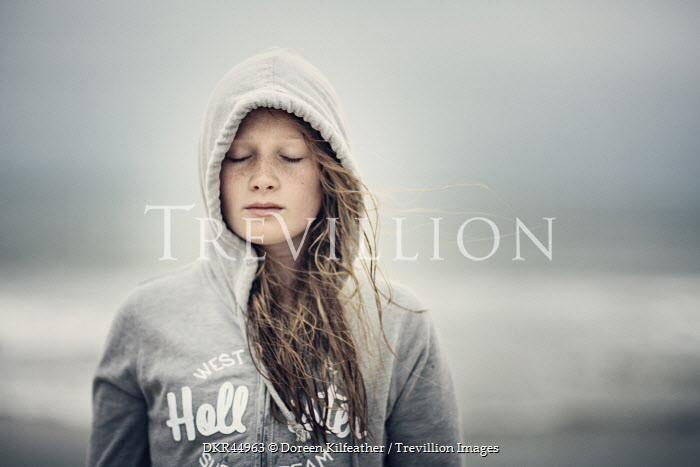 Doreen Kilfeather TEENAGE GIRL IN HOOD ON BEACH Women