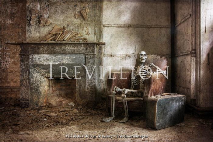 Franck Losay SKELETON SITTING IN DERELICT ROOM Interiors/Rooms