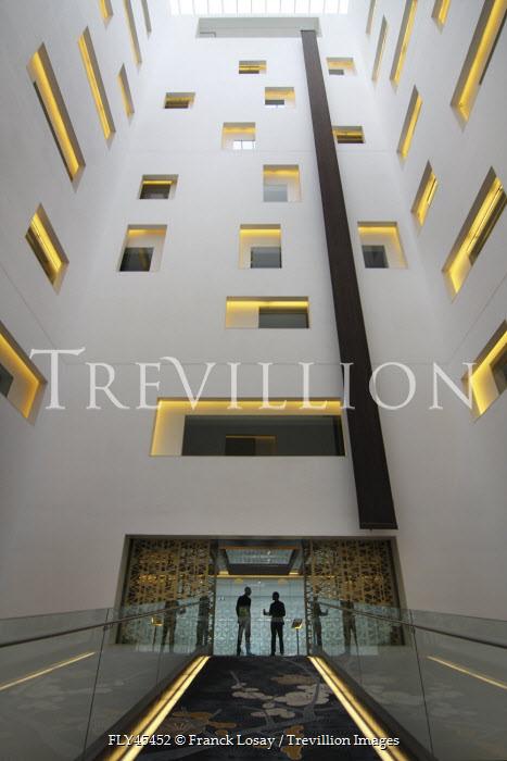 Franck Losay MEN INSIDE MODERN OFFICE BUILDING Miscellaneous Buildings