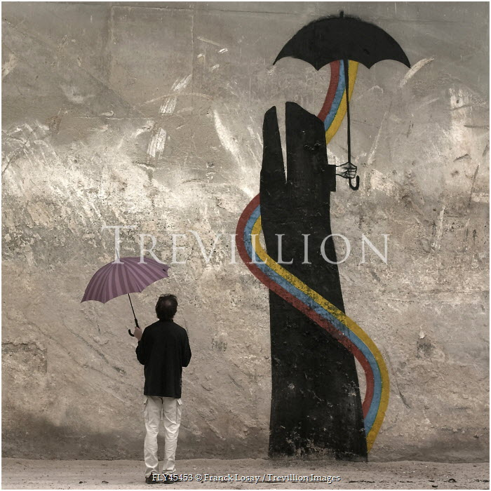 Franck Losay MAN WITH UMBRELLA LOOKING AT SURREAL MURAL Women