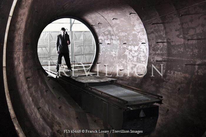 Franck Losay SINISTER MAN IN INDUSTRIAL INTERIOR Men