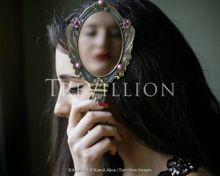 woman holding hand mirror. Kamil Akca WOMAN HOLDING HAND MIRROR WITH FACE REFLECTED Women Woman Holding Hand Mirror