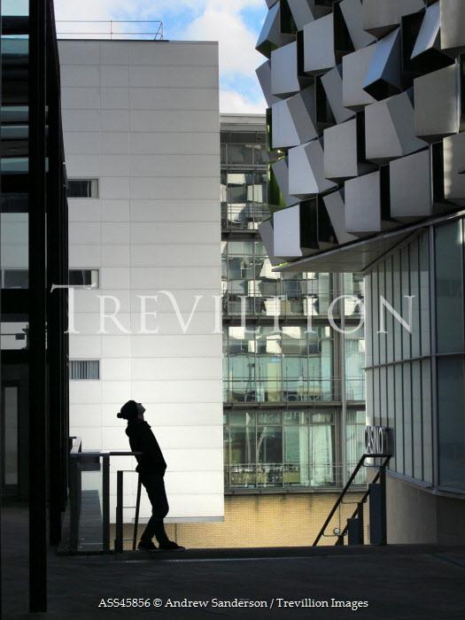 Andrew Sanderson MAN LOOKING UP AT MODERN BUILDING Men