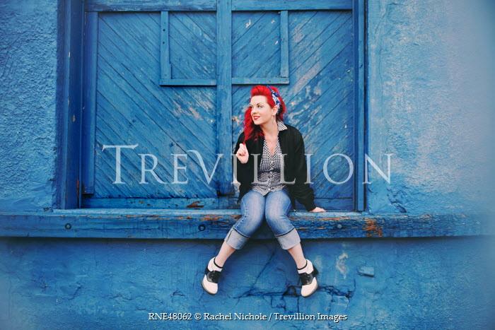 Rachel Nichole VINTAGE WOMAN SITTING ON BLUE WALL Women