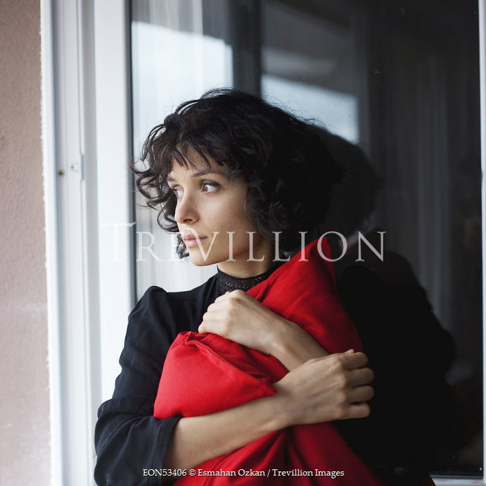 Esmahan Ozkan BRUNETTE WOMAN HUGGING CUSHION Women