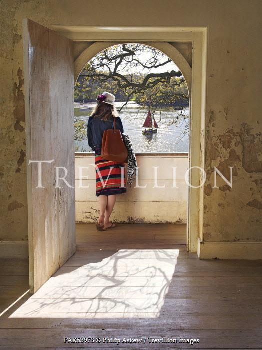 Philip Askew WOMAN ON BALCONY OVERLOOKING LAKE Women