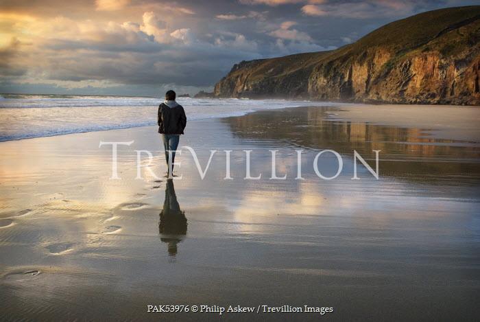 Philip Askew MAN WALKING ON DESERTED BEACH Men