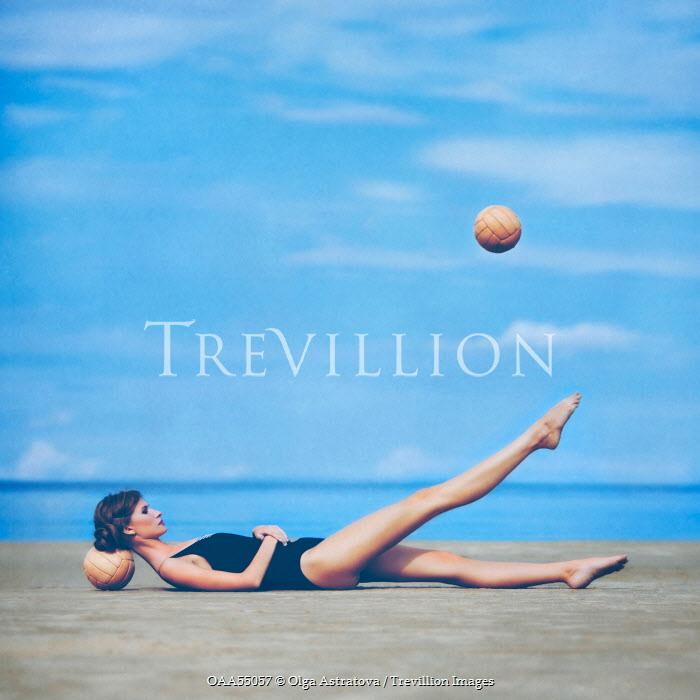 Olga Astratova WOMAN ON BEACH WITH BALLS Women