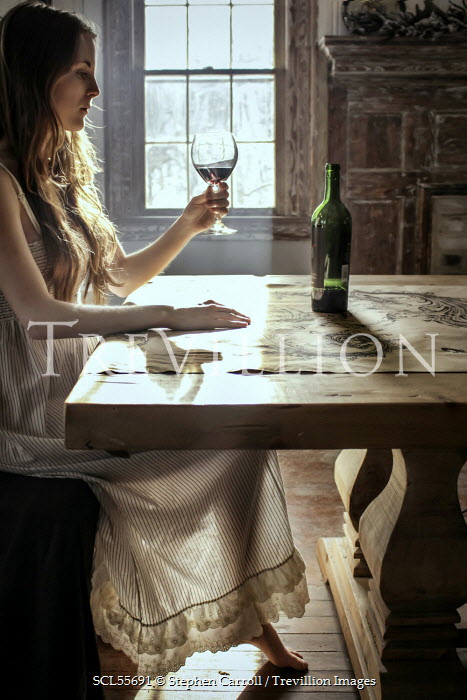 Stephen Carroll WOMAN DRINKING WINE BY TABLE Women