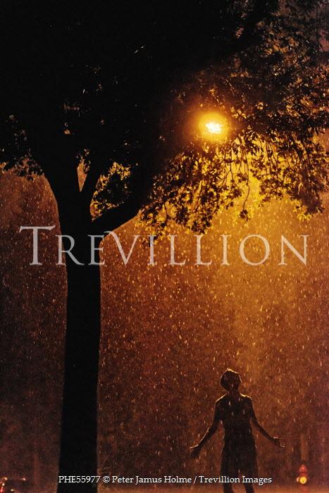 Peter Jamus Holme BOY STANDING IN RAIN BENEATH TREE Men