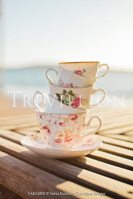 Sanja Kulusic VINTAGE TEACUPS ON TABLE BY SEA Miscellaneous Objects