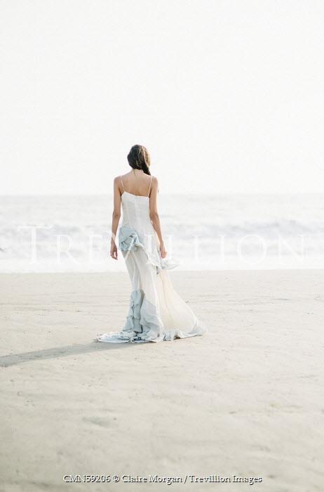 Claire Morgan WOMAN IN DRESS ON BEACH Women
