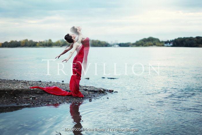 Irina Brana SURREAL WOMEN IN RED DRESS BY WATER Women