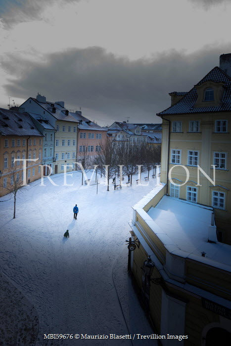 Maurizio Blasetti SNOW COVERED CITY STREET WITH TWO PEOPLE Specific Cities/Towns