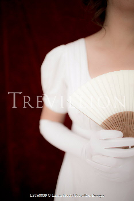 Laura Blost WOMAN IN WHITE DRESS AND GLOVES HOLDING FAN Women