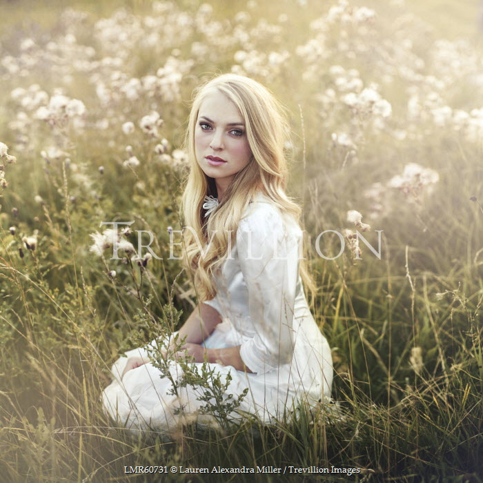 Lauren Alexandra Miller BLONDE WOMAN KNEELING IN FIELD OF FLOWERS Women