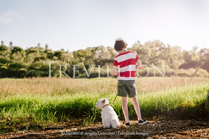 Angela Lumsden YOUNG BOY WITH DOG IN COUNTRYSIDE Children