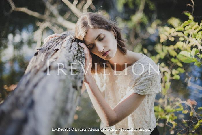 Lauren Alexandra Miller WOMAN LEANING ON TREE BRANCH WITH EYES CLOSED Women