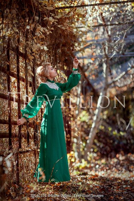 Irina Dzhul WOMAN IN GREEN DRESS IN COUNTRYSIDE GARDEN Women