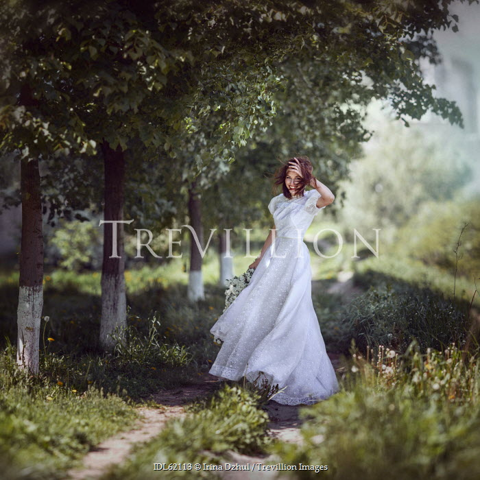 Irina Dzhul WOMAN IN WHITE DRESS ON COUNTRY PATH Women