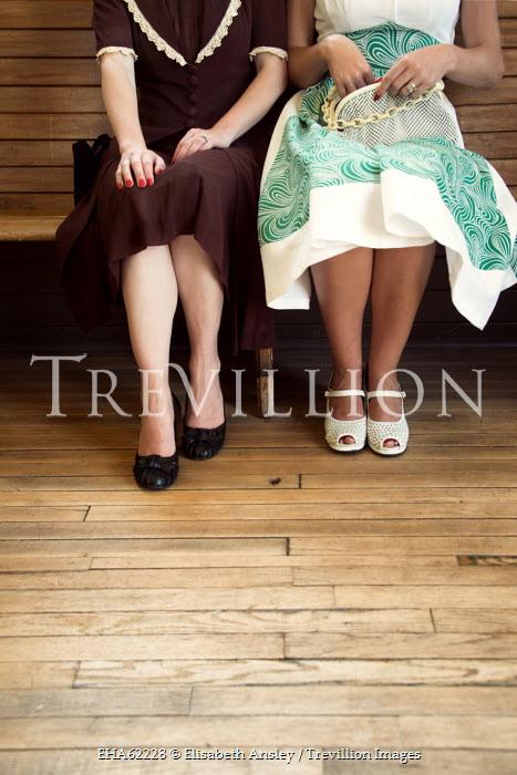 Elisabeth Ansley TWO RETRO WOMEN SITTING ON BENCH INSIDE Groups/Crowds