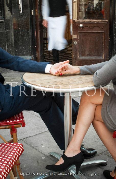 Michael Trevillion COUPLE SITTING OUTSIDE AT PARISIAN CAFE Couples