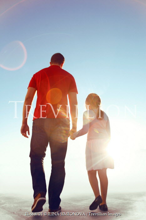 ILINA SIMEONOVA FATHER AND DAUGHTER HOLDING HANDS IN SUNLIGHT Groups/Crowds