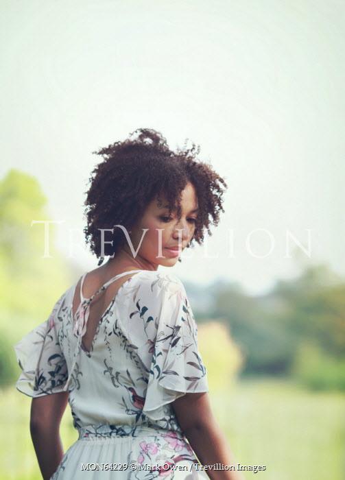Mark Owen YOUNG MODERN BLACK WOMAN IN COUNTRYSIDE Women