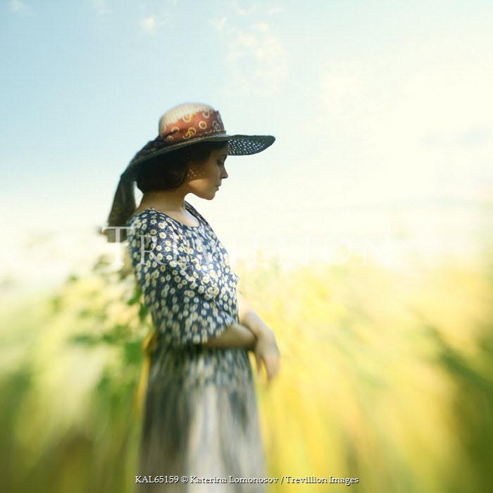 Katerina Lomonosov YOUNG WOMAN IN HAT IN FIELD Women