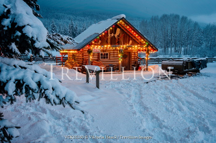 Viktoria Haack CABIN WITH FAIRY LIGHTS IN SNOWY COUNTRYSIDE Houses