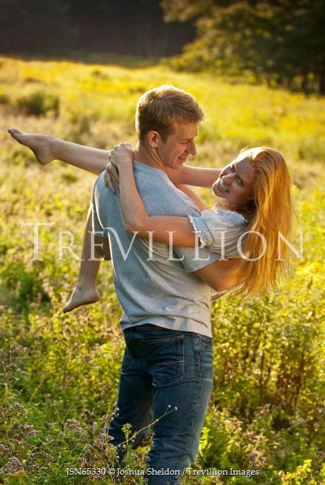 Joshua Sheldon MAN CARRYING HAPPY WOMAN IN COUNTRYSIDE Couples