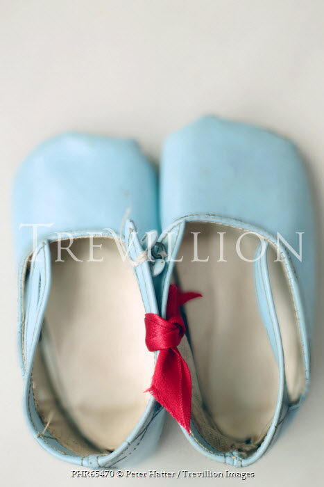 Peter Hatter CLOSE UP OF BLUE BABY SHOES INDOORS Miscellaneous Objects