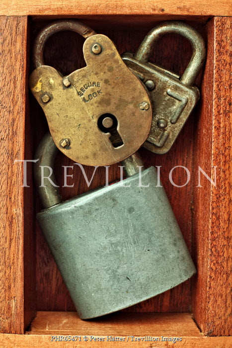 Peter Hatter CLOSE UP OF THREE PADLOCKS INDOORS Miscellaneous Objects