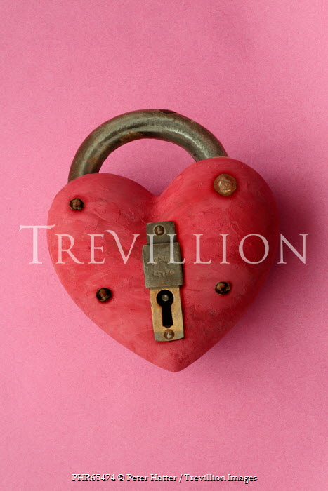 Peter Hatter CLOSE UP OF HEART SHAPED PADLOCK Miscellaneous Objects