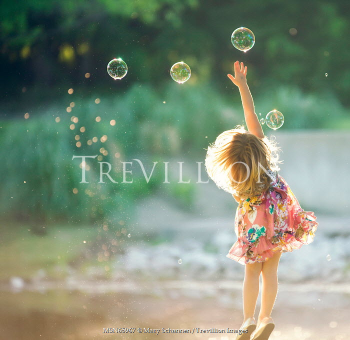 Mary Schannen YOUNG GIRL TRYING TO POP BUBBLES Children