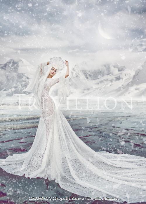 Margarita Kareva WOMAN IN WHITE DRESS IN SNOW Women