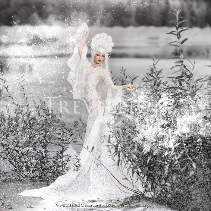 Margarita Kareva WOMAN WEARING WHITE DRESS IN SNOW Women
