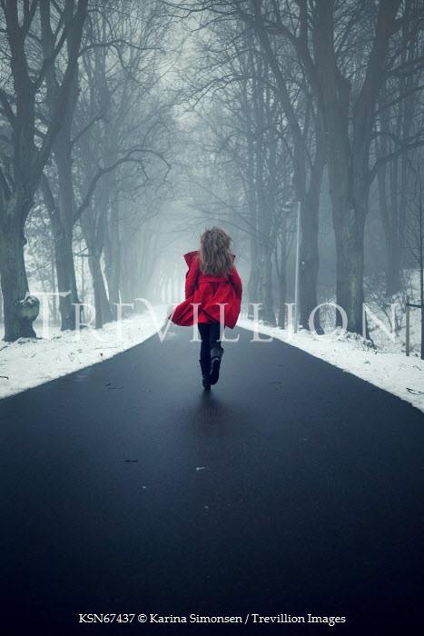 Karina Simonsen WOMAN RUNNING ON ROAD IN WINTER Women
