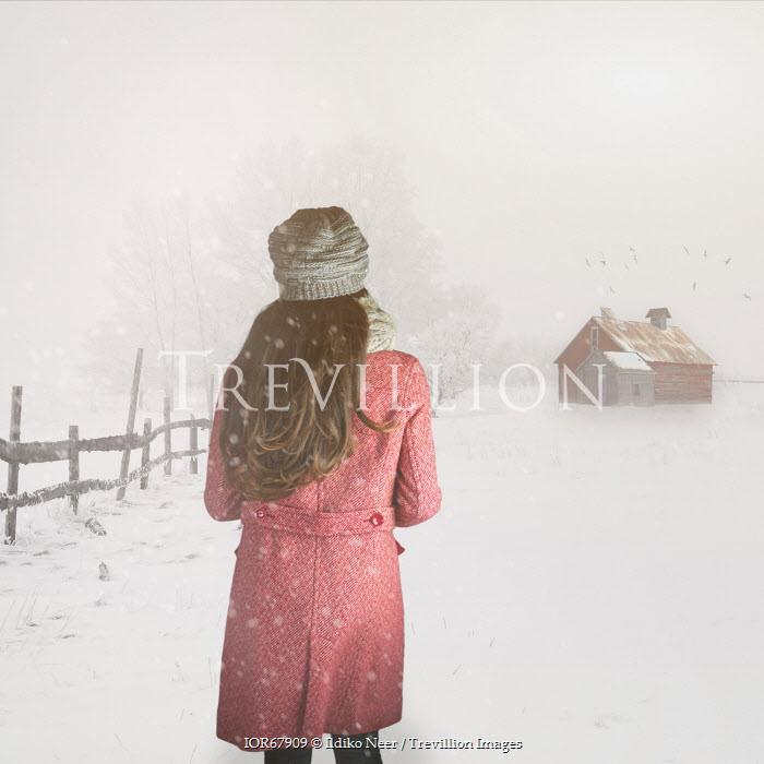 Ildiko Neer YOUNG WOMAN STANDING IN SNOWY FIELD Women