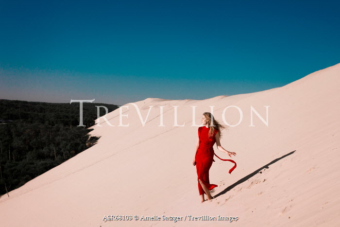 Amelie Satzger WOMAN IN RED DRESS IN DESERT Women