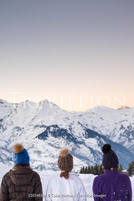 Colin Hutton THREE WOMEN FACING SNOWY MOUTAINRANGE Women