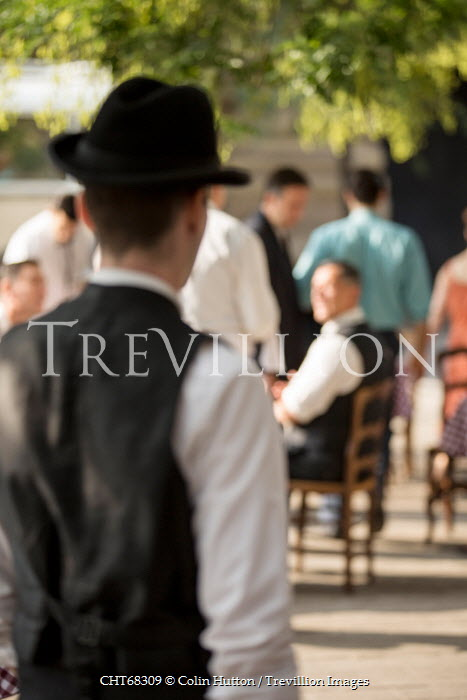 Colin Hutton YOUNG MAN WALKING TOWARDS FORMAL GATHERING Men