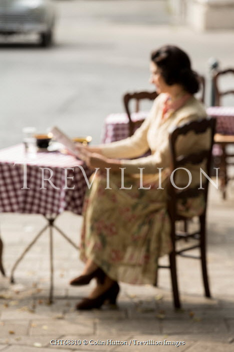 Colin Hutton WOMAN SITTING AT OUTDOOR CAFE TABLE Women