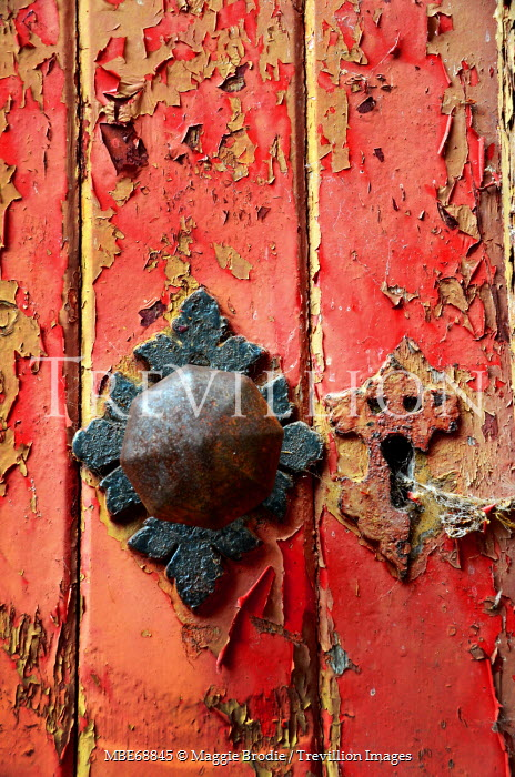 Maggie Brodie CLOSE UP OF DOOR WITH PEELED PAINT Building Detail