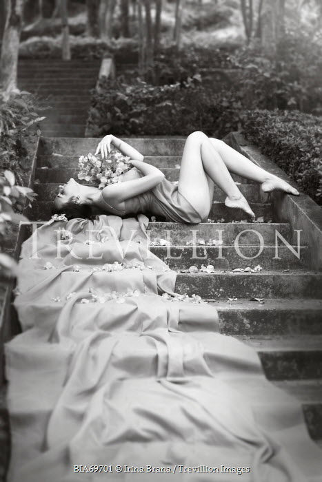 Irina Brana WOMAN LYING ON STEPS OUTSIDE Women
