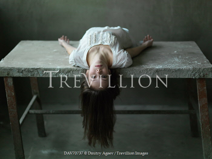 Dmitry Ageev WOMAN LYING UPSIDE DOWN ON TABLE Women