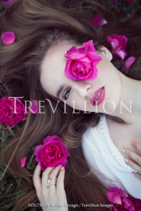 Maja Topcagic YOUNG WOMAN LYING AMONG PINK FLOWERS Women