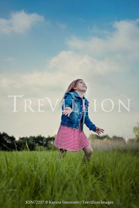 Karina Simonsen LITTLE GIRL PLAYING IN FIELD Children