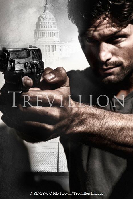 Nik Keevil MAN WEARING T SHIRT POINTING GUN IN CITY Men